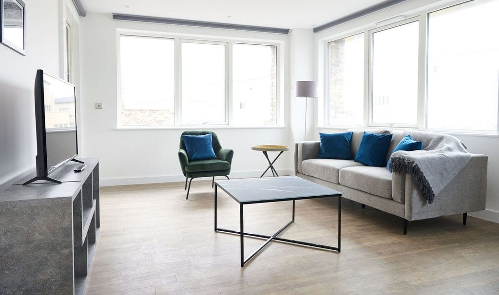 Sitting area with a coffee table and tv